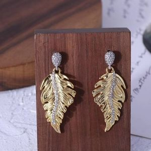 Alexis feather matching shape earrings